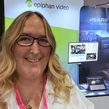 Brigitte in front of the Epiphan Video booth at WFX 2016, with AV.io 4K video capture in the background and a screen showing a picture in picture layout from Pearl-2