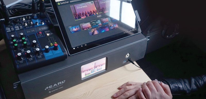 An operator used Epiphan Live on a tablet to switch between the customized event layouts